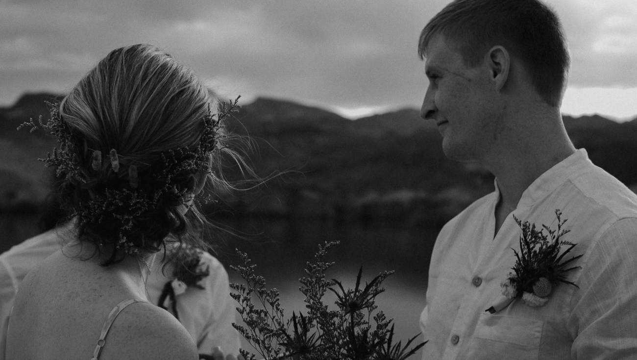 Wedding couple looks at officiant on Nelson's Landing