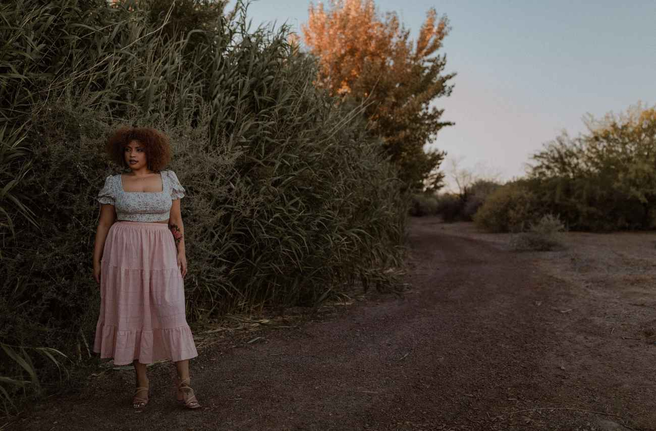 Moody Las Vegas Wetlands Sunset portraits with BIPOC model in pink skirt