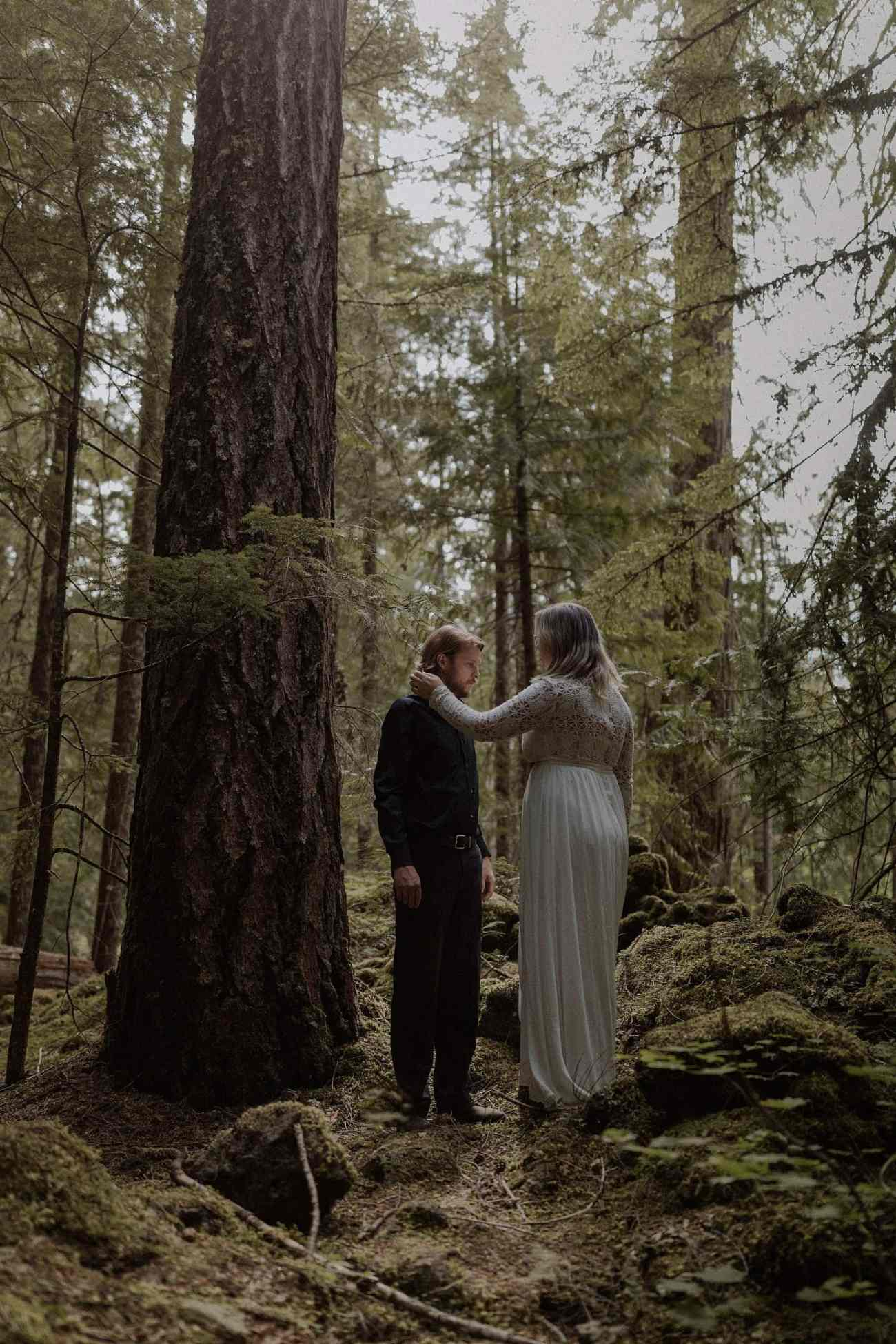 Couple hiking in the forest for their wedding