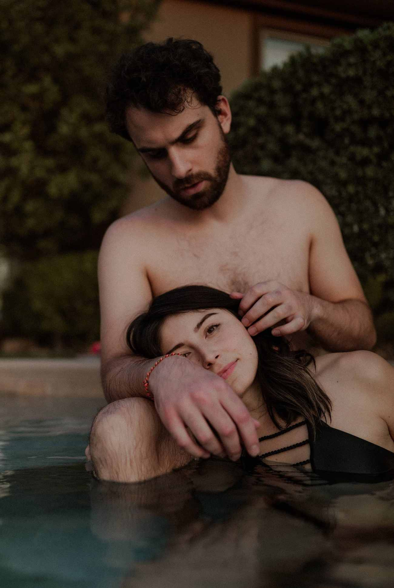 Moody romantic couples photos in pool by Las Vegas Elopement Photographer