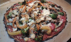cauliflower crust pizza loaded with vegetables