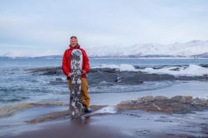 Splitboard standing norwegian beach