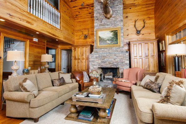 This country cabin decor is finished with books on the coffee table to make it feel lived in.