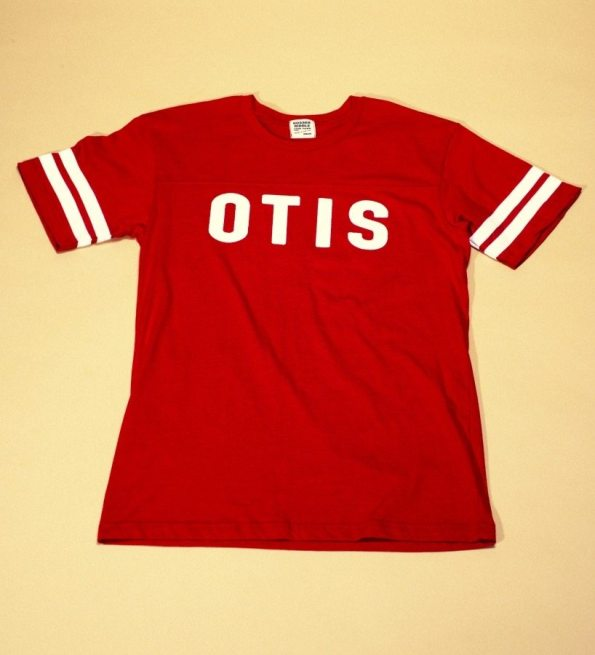 "Father's Day Gift. Red sports style shirt with white lettering and stripes reads: ""Otis""."