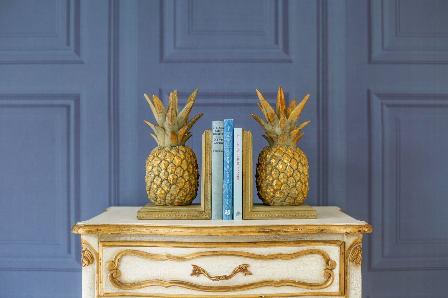 The-French-Bedroom-Co-Pineapple-Bookends-Lifestyle-2043813-1440x960 Pineapple Decor: Tips for Decorating Your Home with Southern Hospitality