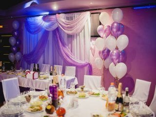Wedding head table with fabric and uplighting