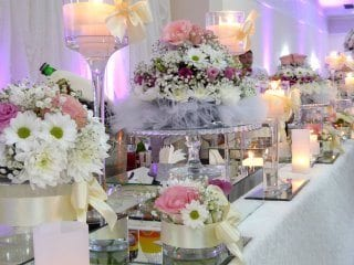 Wedding reception dessert table spot lighted with back uplighting