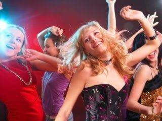 Teen girls dancing at high school dance.
