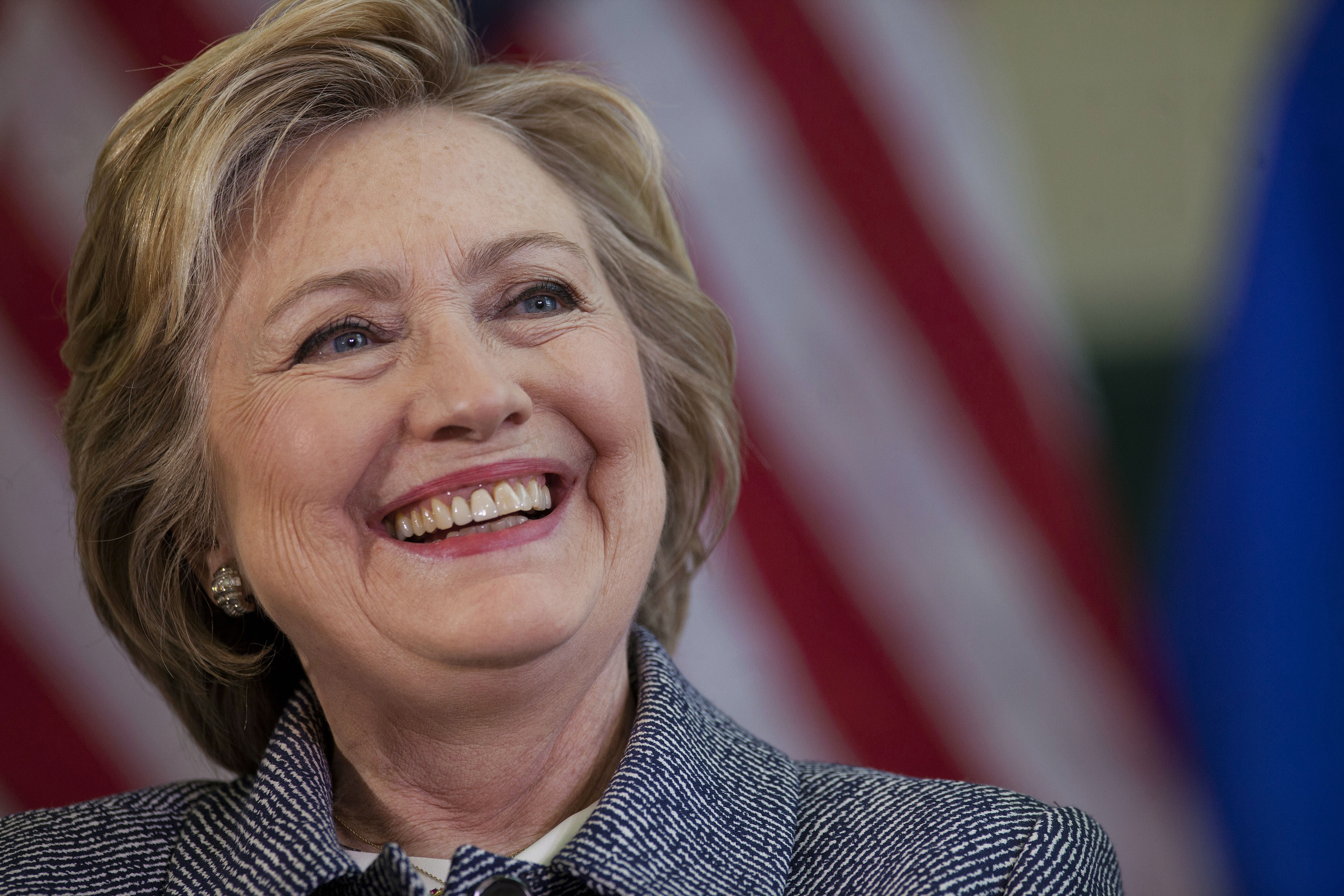 Hillary Clinton, former Secretary of State and 2016 Democratic presidential candidate, smiles while speaking during a campaign event in Hartford, Connecticut, U.S., on Thursday, April 21, 2016. Tuesday night's New York primary not only ended a multi-state losing streak for current front-runners Donald Trump and Clinton, who won roughly 60 percent of the vote each, but also moved them an important step closer to the general election.