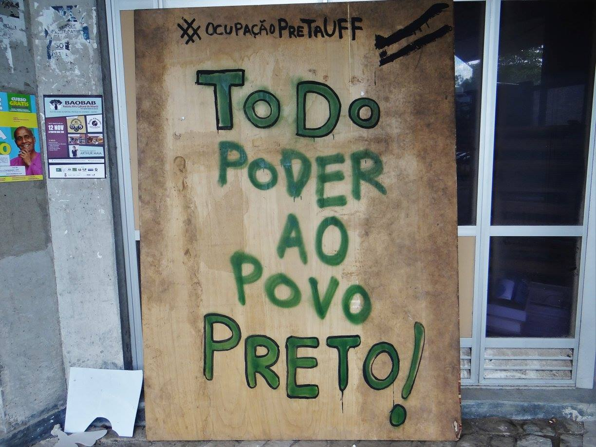 "A sign outside a building reads ""All Power To The Black People"" (Photo from Ocupação Preta UFF)"