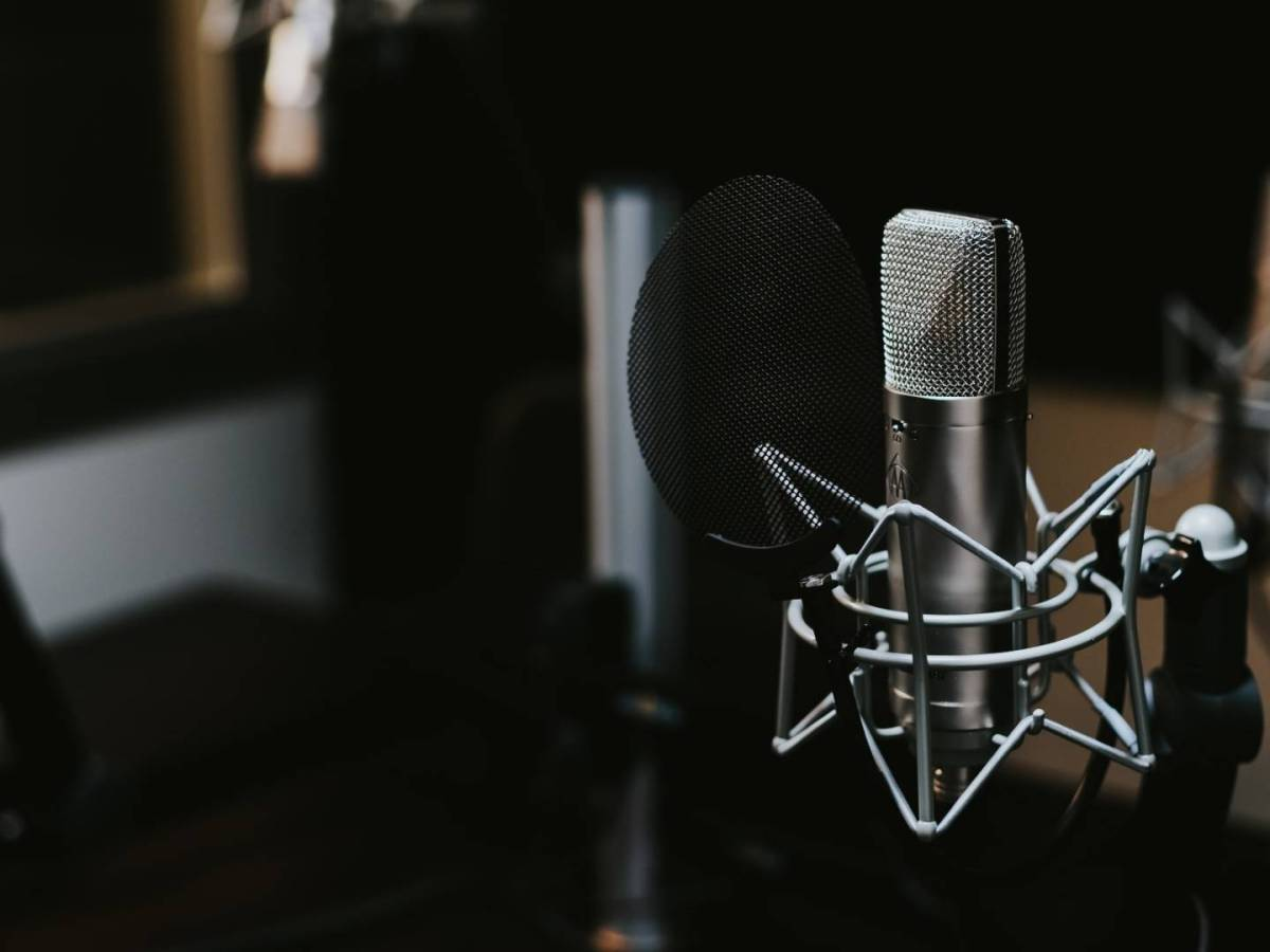 Close-up of microphone in podcast recording studio