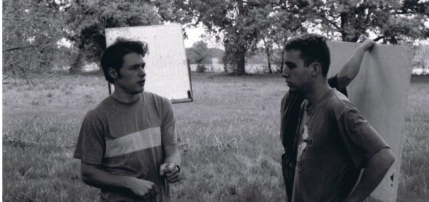 Blake Barham Naleid discusses the shot with actor Marcus Lomas on the set of The Land