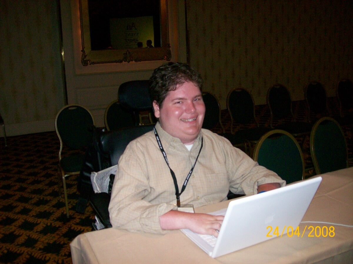 Me at An Event Apart, MacBook open and ready for the next talk to start.