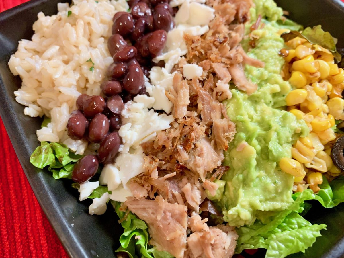 Crispy Carnitas Burrito Bowl with Cilantro-Lime Brown Rice and Easy Guacamole (Instant Pot)  A delicious burrito bowl with crispy carnitas and cilantro lime brown rice cooked in the Instant Pot, layered with black beans, queso fresco, and an easy guacamole.