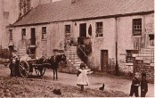 1915 Shuttle Row, Low Blantyre. A favourite photo! Sepia added by PV. Unseen on any other site