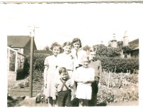 1949. Broompark Road. The children from left to right at the back are Margaret Duncan (Glen), Sheila Ramage (Friend), Nancy Duncan (MacFarlane), John Duncan. At the front is little Archie Duncan and Barhara Ramage. The Ramages were friends of my aunts and uncles (The Duncans).