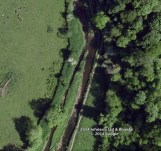 Modern Aerial photo showing possible lade at River.