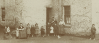 1897 Fourteen people at Shuttle Row, Blantyre works