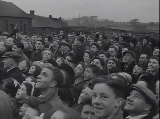 1947 Dixons Pit crowd hositing NCB flag