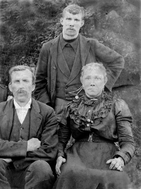 1900 Ben Gold standing, with mother Mary Roberts (Gold) Waddell and his step dad Andrew Waddell