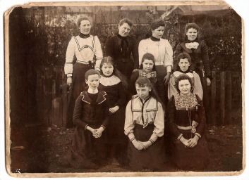 1902 Marion Russell & Sewing Class. Jane Cook on front right.