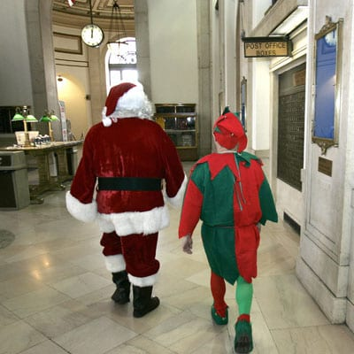 Santa Claus and an Elf leave the Capitol Building after testifying before the House Finance Committee; Claus is asking for money from U.S. taxpayers to help fund Christmas this year