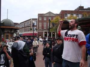 John Murphy (right) speaks to crowds in Harvard Square during an October rally.  (Blast Staff photo/John Stephen Dwyer)