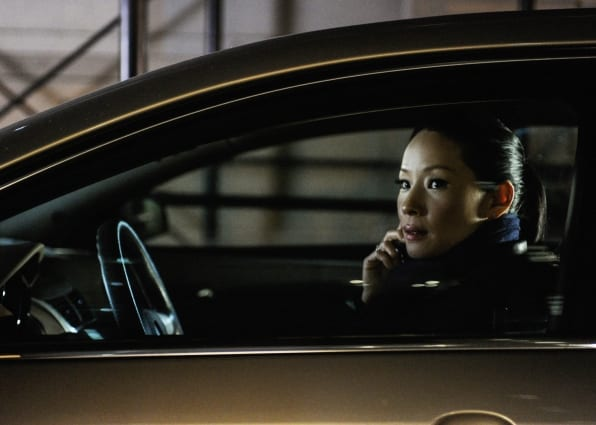 Watson (Lucy Liu) stakes out at her first case alone.