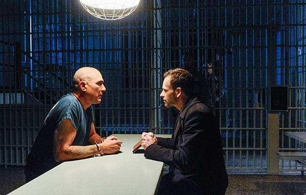 Sherlock (Jonny Lee Miller) needs information from Moran (Vinnie Jones).