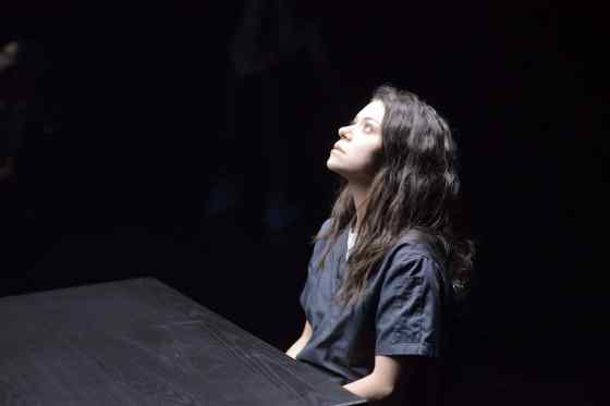Sarah (Tatiana Maslany) hands herself over in the season two finale of Orphan Black.