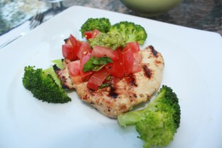 Grilled bruschetta chicken with balsamic tomatoes and steamed broccoli, topped with homemade mint-pea pesto