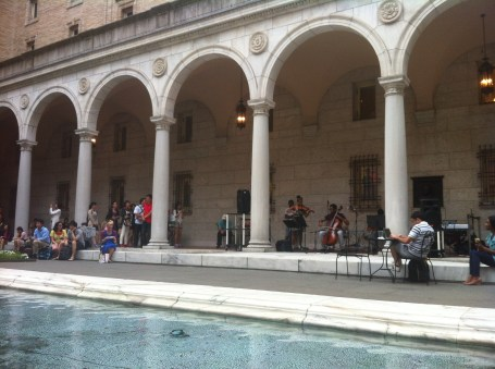 Kendall and his band playing under the arches as we watch by the fountain
