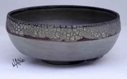 Flat ceramic bowl. Crawl glazes and Terra Sigillata crackle.