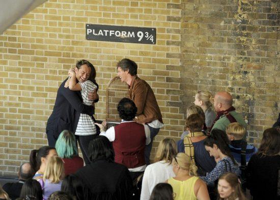 Eddie Redmayne and Jude Law, stars of Fantastic Beasts: The Crimes Of Grindelwald, surprise fans at platform 9 3/4 during 'Back to Hogwarts' day celebration at Kings Cross Station on September 1, 2018 in London, England.