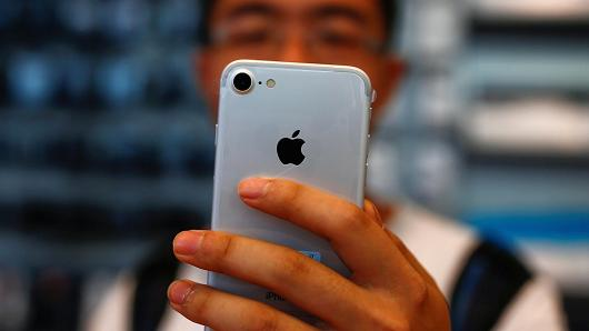China fires its first warning shot, warning iPhone sales will suffer if Trump starts a trade war