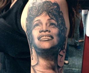 10th R&B Queen Whitney Houston. The tattoo artist really hit this tattoo out the park.