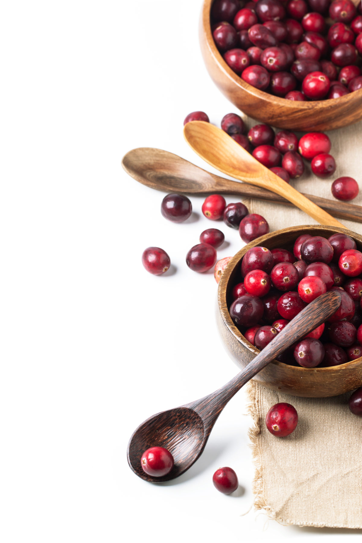Wooden bowl of cranberries
