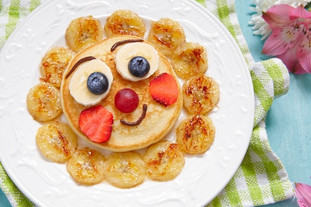 funny breakfast pancakes with fruits for kids