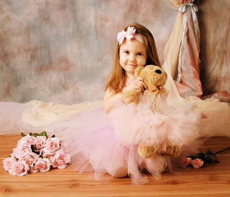 ittle girl dressed as a ballerina in a tutu