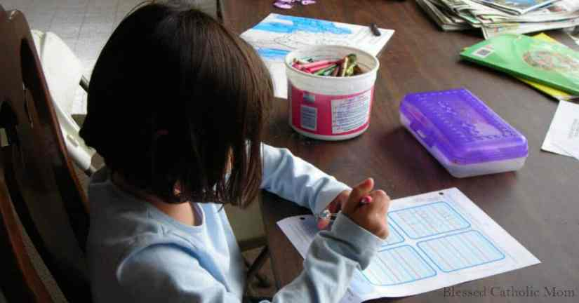 Successful plan your homeschool year. Image of the profile of girl working on schoolwork at a desk.