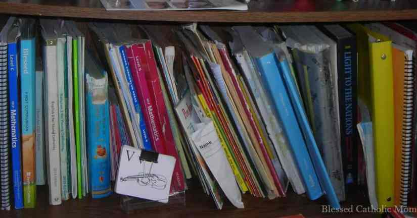 Follow these 5 simple steps to successful organize your school year. Image of a shelf of books and materials for a homeschooling family.