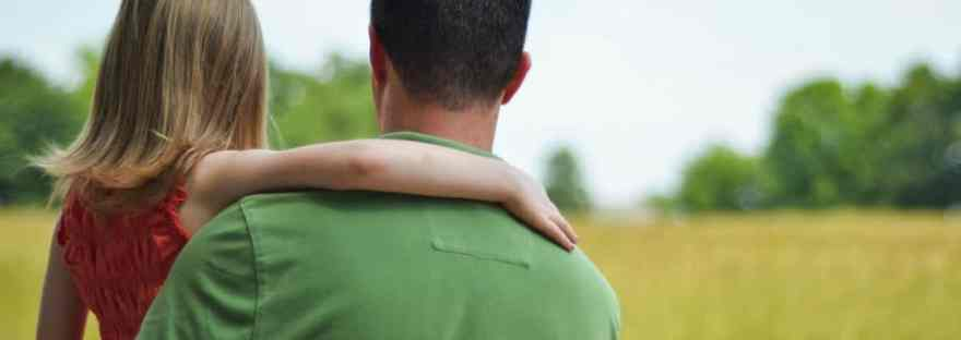 My husband does not babysit our kids. Father holding daughter-view from behind them