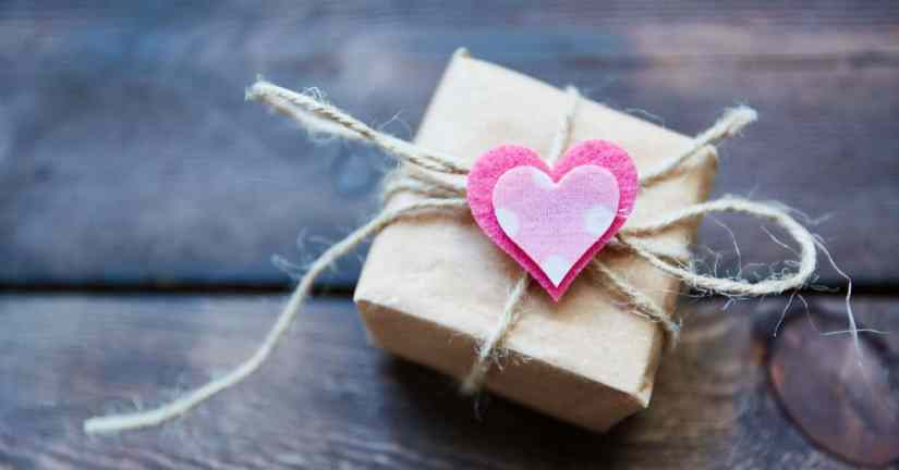 Do you and your spouse yearn to grow closer as a couple, yet think you'll never be close again? You can grow closer. It is possible and worth the effort! Do little things for your spouse that will bring a smile to his face. Image of a small box wrapped in brown paper and tied with twine with a heart on it.