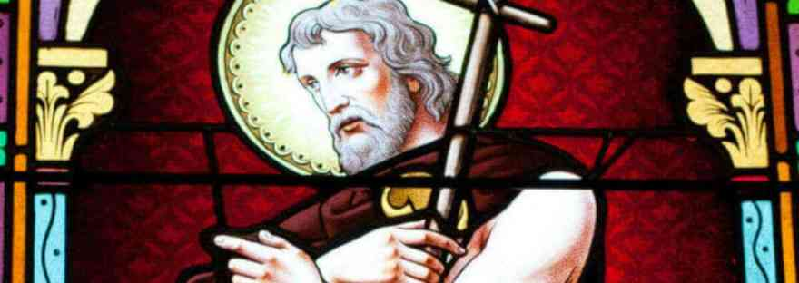 The saints are our friends. More than our friends, they are our family in Christ. We can ask them to pray for us. Image of a stained glass window of John the Baptist.