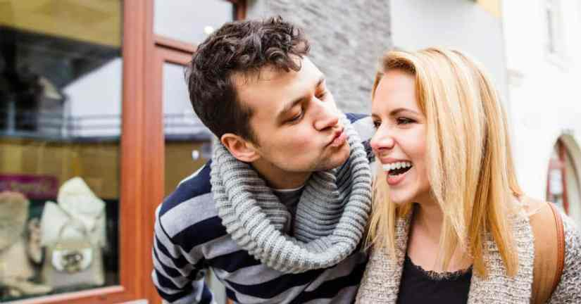 Do you and your spouse yearn to grow closer as a couple, yet think you'll never be close again? You can grow closer. It is possible and worth the effort! Be joyful. People like being around people who are joyful! Image of a couple walking and the man is trying to give his laughing woman a kiss.