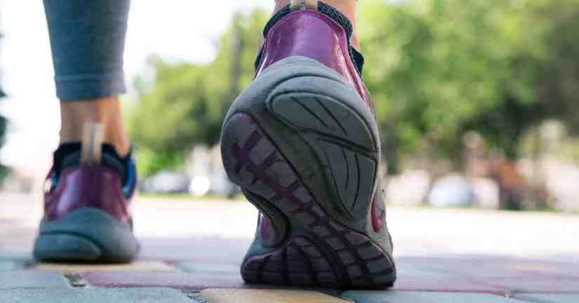 To help have a positive attitude, do what you can to squash a bad attitude. Image of two shoes on the pavement.