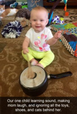 cute baby playing pots and pans