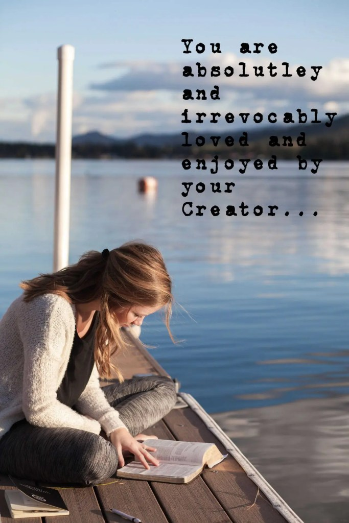 Rejection is a trial, depend on God. Reading Bible on dock.