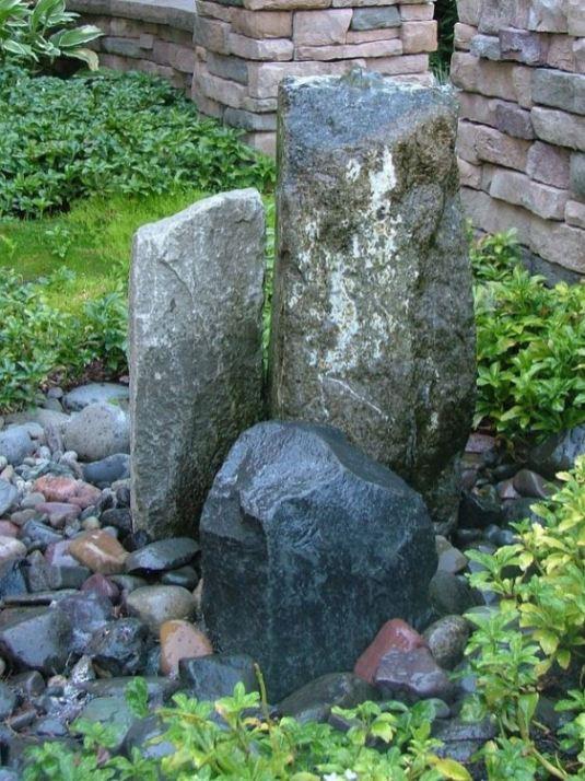 column bubbler with accent boulders
