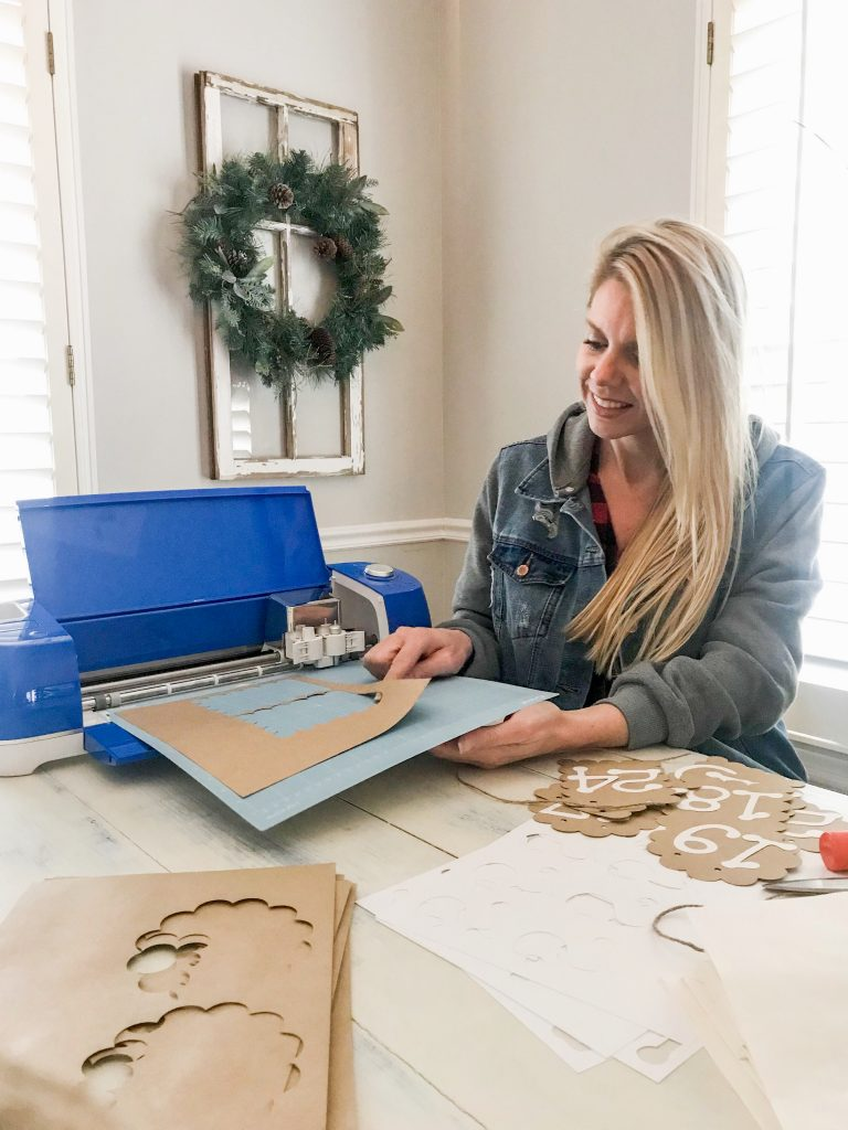 image of Carissa using Cricut machine